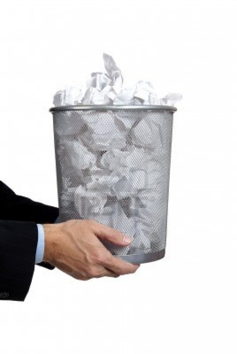 5901042 business man holidng a trash can full of papers on a white background with copy space